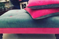 pink fabric low footstool ottoman